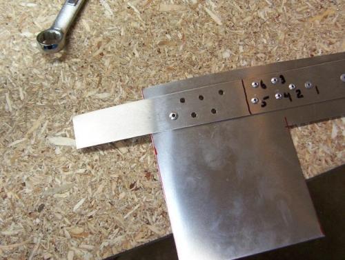 Testing rivet head shape.