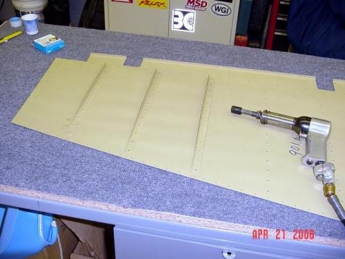 Back rivet stiffeners to skin.