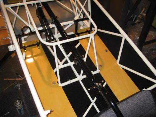 Aft floor boards and rear seat rudder/brake pedals