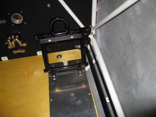 Rudder and brake push/pull tubes visible to the right of the pedal mechanism