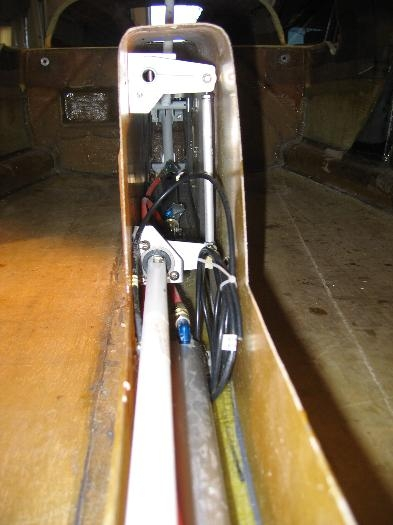 Pushrod assemble seen as white vertical rod on right.