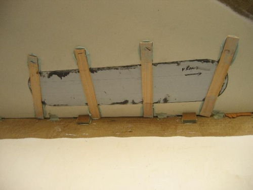 Paint sticks holding plexi in place