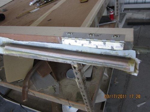 String of weights glassed onto aileron