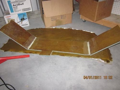 Bottom of baggage panel