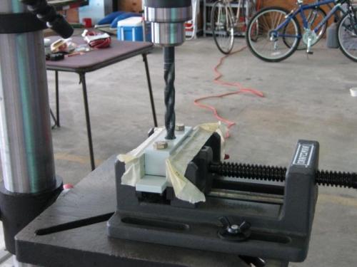 Mach drilling the wear plate to attach bracket