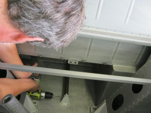 Match drilling the rudder pedal socket to the slide bar. Both are temporaily mounted