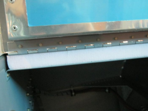 hard foam inserted with door hinge in upper fwd chanel brace