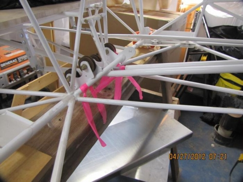 Passenger side view rudder cable pulley installation.