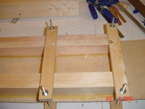 Clamps for bonding plywood to spar caps