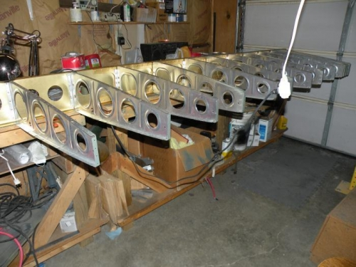 The first thirteen main ribs riveted to the left main spar.