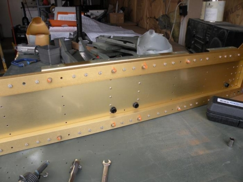 The two inboard seat ribs riveted to aft F-704 bulkhead.