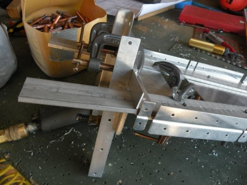 A rather convoluted clamping arrangement to positon the F-711C angle for drilling.