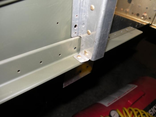 The one rivet holding the F-902R bulkhead to the right lower longeron.