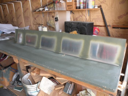 Inside of right flap bottom skin scuffed, cleaned, and primed.