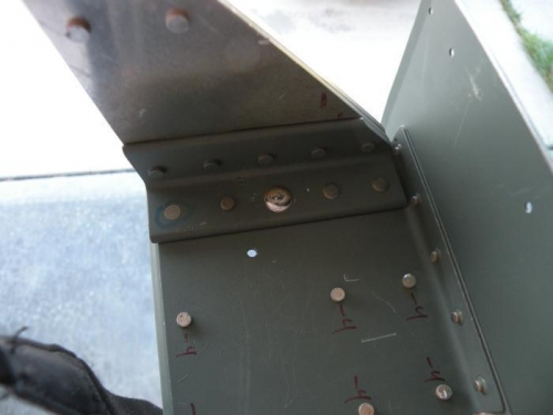 #6 rivet in left outboard aileron bracket.