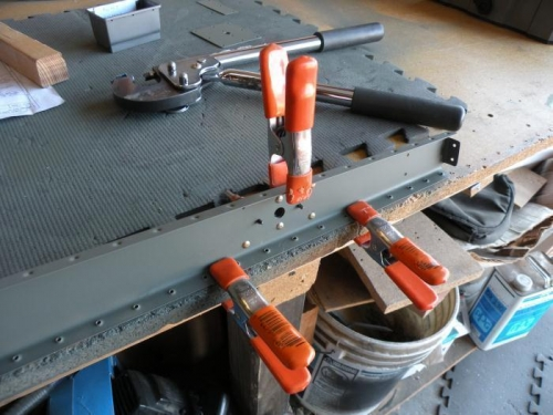 Riveting the hinge reinforcement plates.