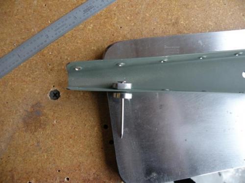 Pop rivet dimple dies in aft section of rudder bottom rib.