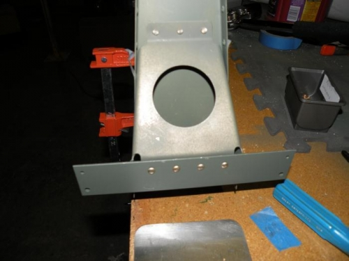 I was able to reach all four of the rudder brace to rudder horn rivets with the longeron yoke.