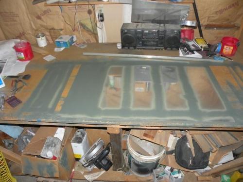 Interiors of top left inboard skin and wing walk doubler primed.
