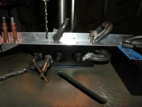 Setup for backdrilling the bearing blocks through the forward skin stiffener.