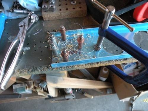 Match drilling an aileron spar reinforcement plate.