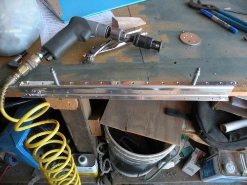 Countersinking the trim tab spar.