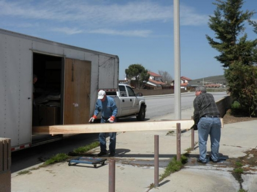 Mike (driver for Partain), Hal Lyons (RV-7 builder/flyer), and me unloading spar box.
