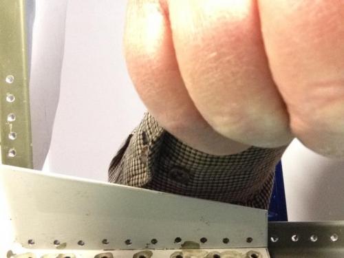 Right forward gusset rivet holes after deburring.