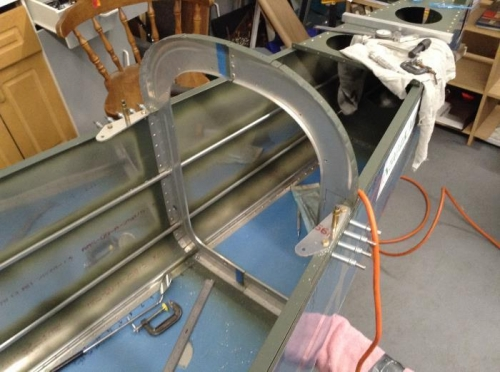 Shoulder harness anchors drilled to main longerons just forward of the F-708 bulkhead.
