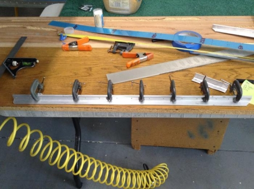 One angle clamped to its opposite side mate for drill marking the holes.