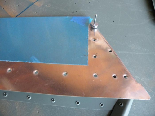 Using the pop rivet dimple dies for the horn attach holes aft of the trim tab spar.