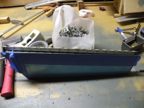 Trim tab complete except for blind riveting end closeouts.