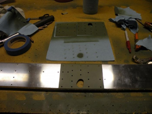 Aileron bracket reinforcement plates and rear spar prepped and primed.