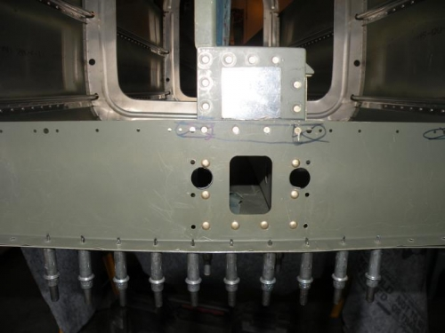 F-706B bottom bulkhead riveted to the F-728 and F-729 bellcrank ribs.