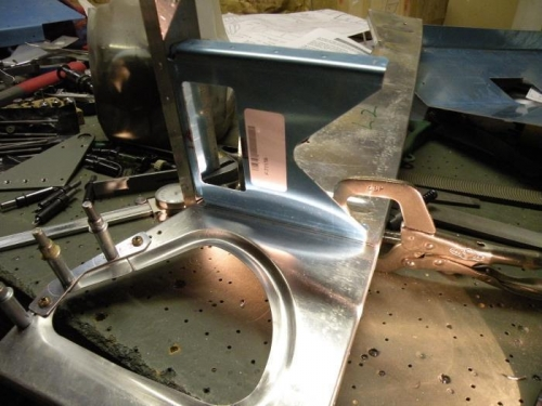 The aft bracket aligned and clamped for drilling.