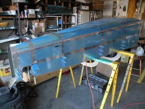 Aft fuselage skin riveting completed.