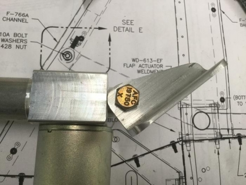 The radius on the F-766B actuator angle has to clear the gearbox housing on the actuator.