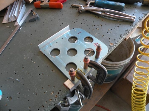 Set up to drill a support angle to the pilot's left brake pedal.