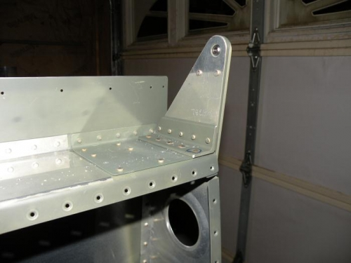 Right outboard aileron hinge bracket assembly riveted to rear spar and end rib.