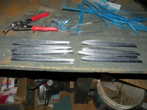 Eight stiffeners ready for final drilling to skin.