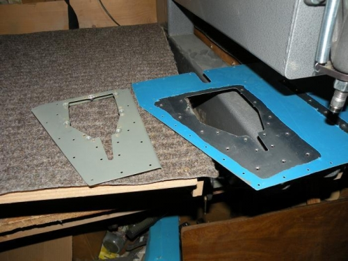 Nutplates installed on reinforcement plate, skin dimpled.