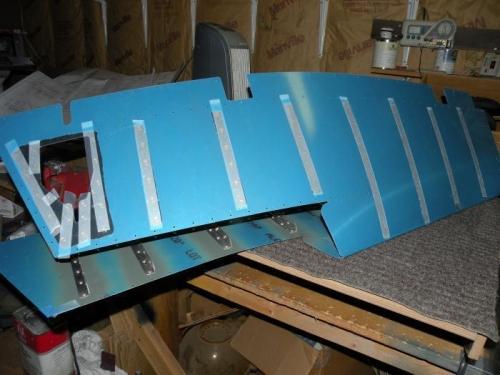 Rivets loaded on bottom of left elevator skin.