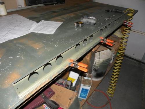 Bottom flange of left flap spar is countersunk.