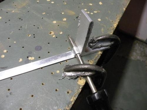 Jig for fabricating vent line clips.