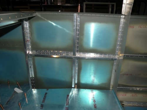 Horizontal and vertical aft fuselage bulkheads clecoed in.