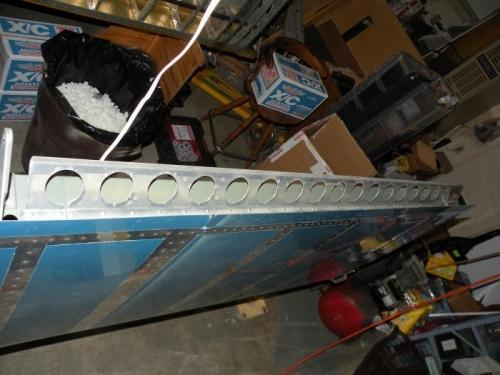 Flap brace riveted to rear spar.