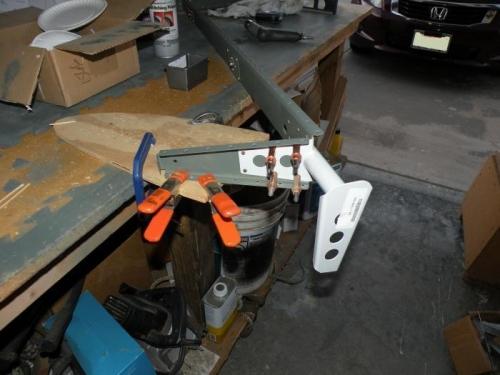Riveting the WD-605-1-L elevator horn to the left elevator skeleton.