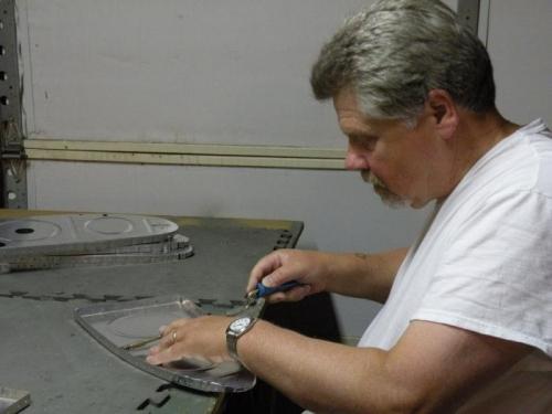 Deburring left tank rib rivet holes.