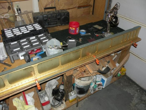 Right lower spar flange primed and nutplates riveted.