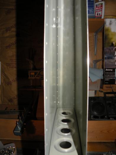 Skin riveted to upper front spar VS-702.